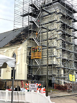 Street level view of scaffolding at church steeple fire.