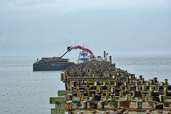 Lynnhaven Fishing Pier-view of pier during piling removal by barge.