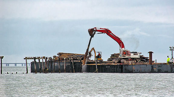 Lynnhaven Fishing Pier-view showing excavator removing pilings from barge.