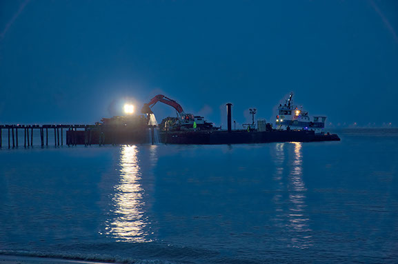 Lynnhaven Fishing Pier-view showing barge lights and piling removal at night