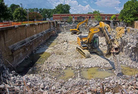 Excavators clearing out rubble to be reused in lanscaping of Water Treatment Plant, after heavy demolition.